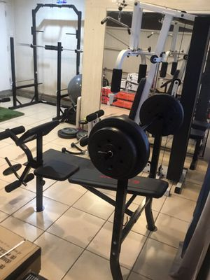Gym Equipment bench press with 80 weight set combo with preacher curl and leg extension for Sale in Pico Rivera, CA