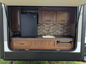 Immaculate 2015 camper with bunkhouse 11,000 lbs you need at least a 2500 to tow it. Bunkhouse with outdoor kitchen and 3 slides. Sleeps 11-12 for Sale in Hudson, NH