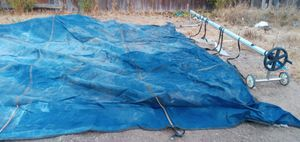 Swimming pool cover tarp with rolling reel for Sale in Fresno, CA