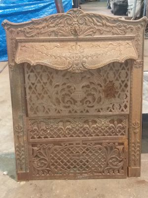 Cast iron fireplace surround for Sale in Tivoli, TX
