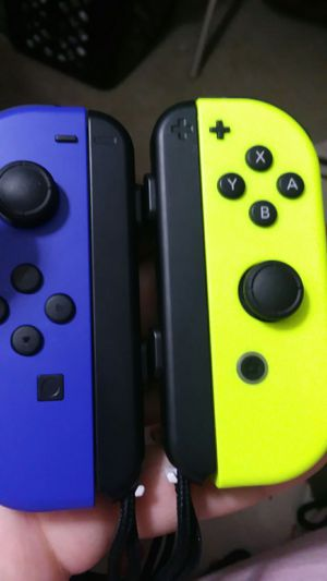 Nintendo joycons blue and yellow for Sale in Palmyra, PA