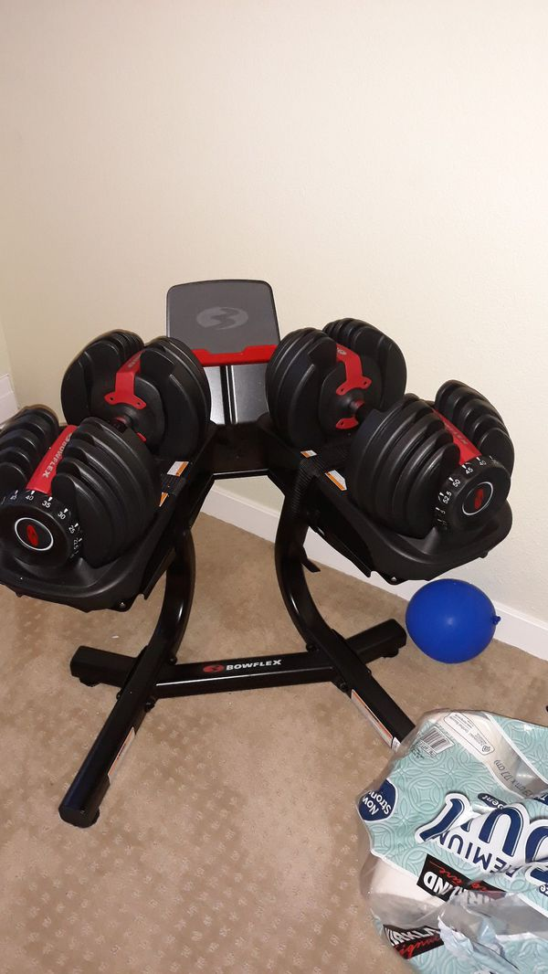 Bowflex dumbbells 552lbs with stand and bench. Excellent condituons
