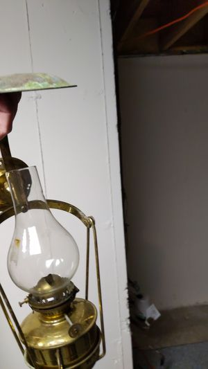 Oil lamp for a sailboat and brass bell for Sale in Naperville, IL