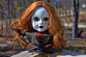 A doll head assemblage art piece for Sale in Roxboro, NC