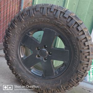 One Jeep wheel and tire for Sale in Fresno, CA
