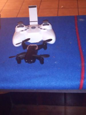 The white drone is a E 61 serious Mimi drone and the other one is a prpel idk what worng with it for Sale in Wichita, KS