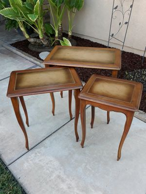 BEAUTIFUL VINTAGE 3PC. LEATHER INLAY TOPS NESTING TABLE SET for Sale in Corona, CA