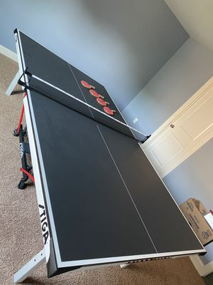 Stiga brand ping pong table and 4 paddles for Sale in Mt. Juliet, TN