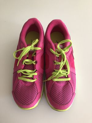 Nike tennis shoes, size 4.5Y, Never worm. My daughter's feet had a growth spurt. for Sale in Franklin, TN