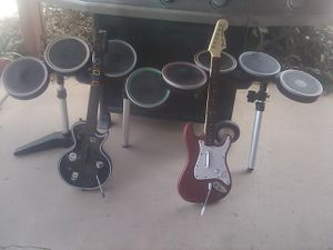 guitar hero Gibson Xbox guitar, fender Stratocaster PlayStation guitar, and two top drum sets PlayStation. Must sell ASAP for Sale in Tucson, AZ