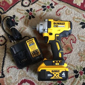 DEWALT 20V XR Brushless 1/2 inch Mid Torque Impact Wrench With Battery and Charger for Sale in Nashville, TN
