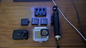 Action camera, selfie stick & extra batteries with charger for Sale in Clayton, NC