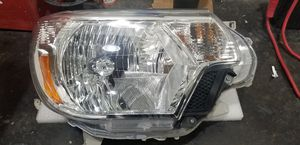 OEM factory 2012 - 2015 Toyota Tacoma passenger side headlight for Sale in Port Orchard, WA