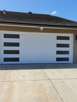 New Garage Doors / Opener / Keypad / Controls / Sensor / Rolers / Spring / Cables / Tracks / Hinges / Bottom Seal And More for Sale in Compton,  CA