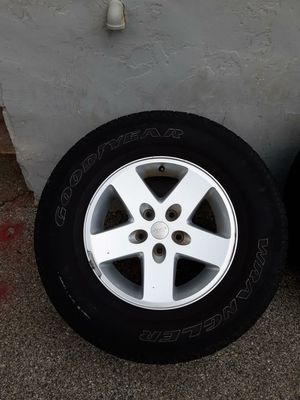 Jeep wrangler wheels and tires (set of 5) for Sale in Philadelphia, PA