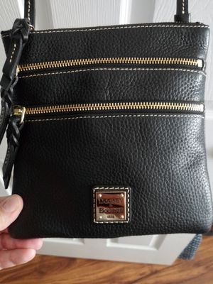 Authentic Dooney & Bourke black triple zip crossbody purse NWT..Makes a great gift. for Sale in Kernersville, NC