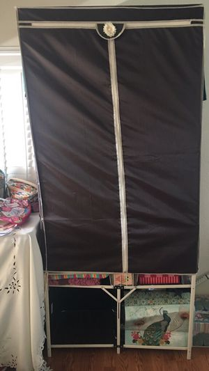 Storage/Garment Rack with shelving and double zippered cover for Sale in Montgomery Village, MD