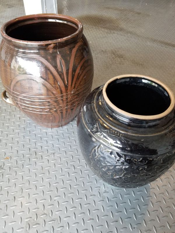 2 decorative original Korean stone pots/vases. These pots are original stone vases that were used to ferment soybeans.