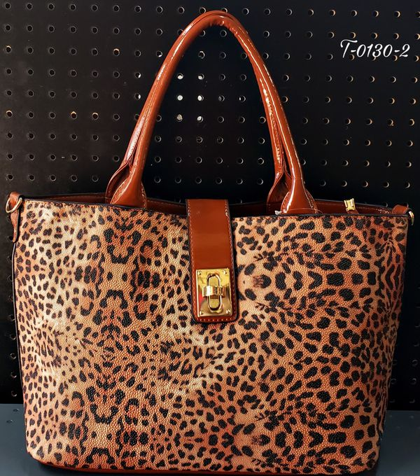 New Tan and black leopard print Hand bag.