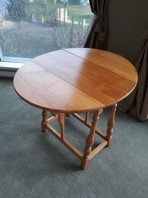 """Antique small pine table. Use as end table, night stand or taller coffee table. Measures 25"""" T, 26"""" W, 31"""" L with leaves, 13"""" L leaves dropped. for Sale in Bonney Lake, WA"""
