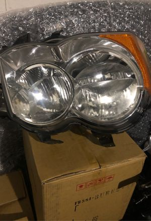 Factory Used Headlight 2009 Jeep Grand Cherokee for Sale in Lancaster, PA