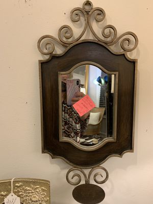 Nice heavy metal mirror made well with the candle holder at the bottom. for Sale in Doraville, GA
