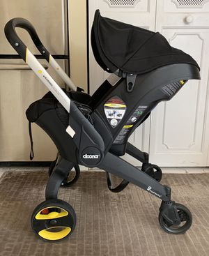 Doona Infant Car Seat with wheels for Sale in Pembroke Park, FL