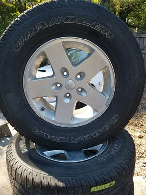 Set of 4 used tires and wheels 5 lugs size 17 fit Jeep Wrangler for Sale in Nashville, TN