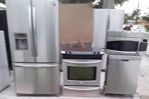 BEAUTIFUL STAINLESS STEEL FRENCH DOOR REFRIGERATOR SLIDE IN CONVECTION STOVE DISHWASHER MICROWAVE for Sale in Palm Beach Gardens, FL