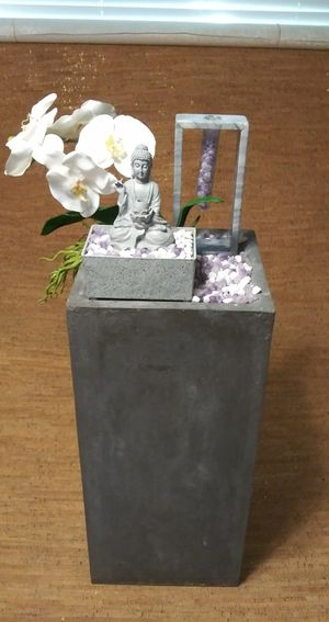 Beautiful one-of-a-kind Buddha fountain on pedestal with amethyst rocks an artificial flower for Sale in Miami, FL