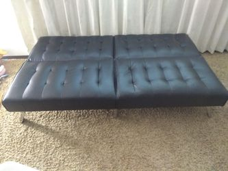 Futon leather sofa cum bed for Sale in Muscatine,  IA