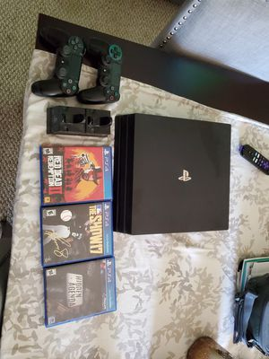 Ps4 pro. 3 games, 2 controllers, charging station for Sale in Everett, WA