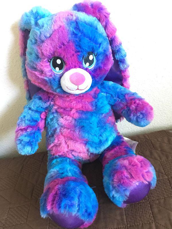 Stuffed teddy bear and hello kitty.