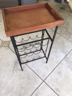 Cute wine rack. Holds 16 bottles with top tray. Not perfect but nice. Comes with two wall mounted wine bottle racks that hold 4 bottles each for 24 for Sale in Orange, CA