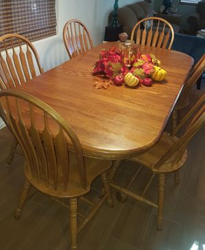 Beautiful solid oak dining set six chairs and a leaf $2,000 new for Sale in Gilbert, AZ