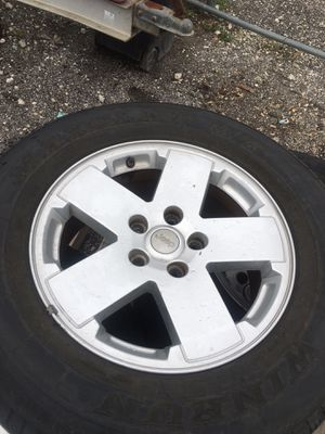 Set of 4 plus spare Jeep Wrangler 18 wheels great shape tires good to for Sale in Homestead, FL