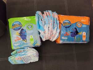 Toddler Swim Diapers Size 3 & 4. Extras included. for Sale in Salt Lake City, UT