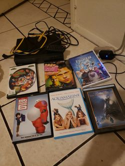 DVD Player with cables, remote + DVDs for Sale in Mesa,  AZ