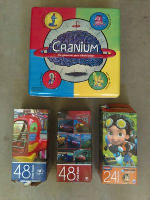 Three puzzles and one board game for Sale in Maricopa, AZ