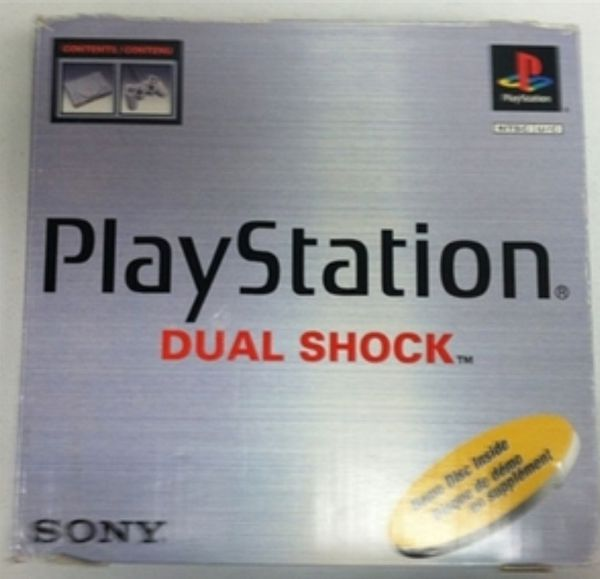 Playstation 1 system in box with games.