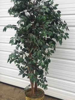 Artificial tree/slightly less than 7 feet tall for Sale in Columbus,  OH