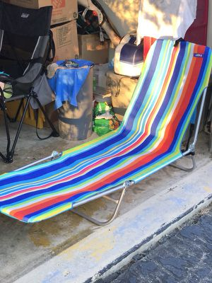 Folding Beach chair with carrying handle and backpack straps for Sale in Bowie, MD
