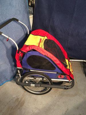Schwinn running stroller (also attached to bike) for Sale in Leesburg, VA