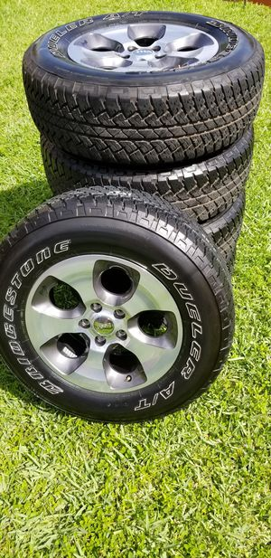 "Set of 5 jeep Wrangler 18"" rims with Bridgestone tires. for Sale in Miami, FL"