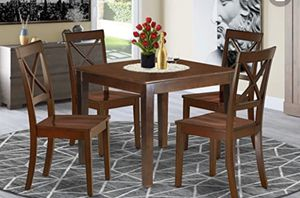 Table and four chairs. (New in Box) for Sale in Akron, OH