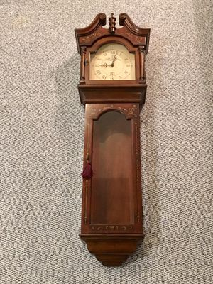Wall mount battery powered Grandfather style o'clock. With internal storage shelving area for Sale in Portland, OR