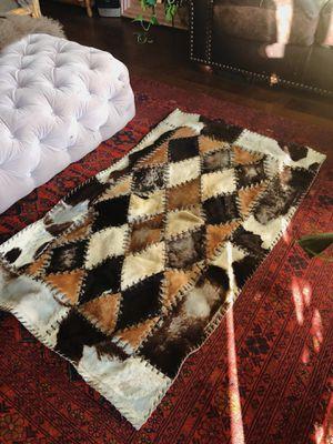 Animal hide western style rug for Sale in Las Vegas, NV