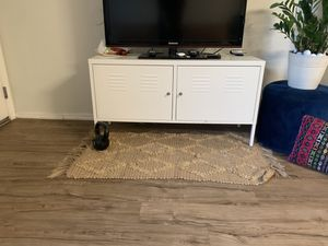 Ike's off white two door dresser/tv stand. Two shelves inside and comes with two keys to lock it. Bought new for 120$ for Sale in Phoenix, AZ