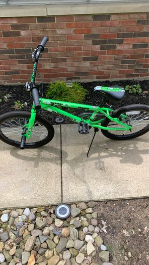"Boys 20"" Mongoose Mountain bike with front pegs for Sale in Broadview Heights, OH"