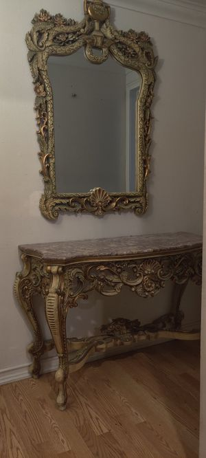 Table color: gold with marble for top comes with mirror. Beautiful designs for Sale in El Monte, CA